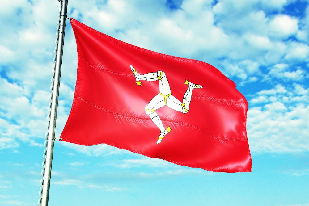 Triskelion flag of the Isle of Man - a triskelion in white and yellow on a red background.