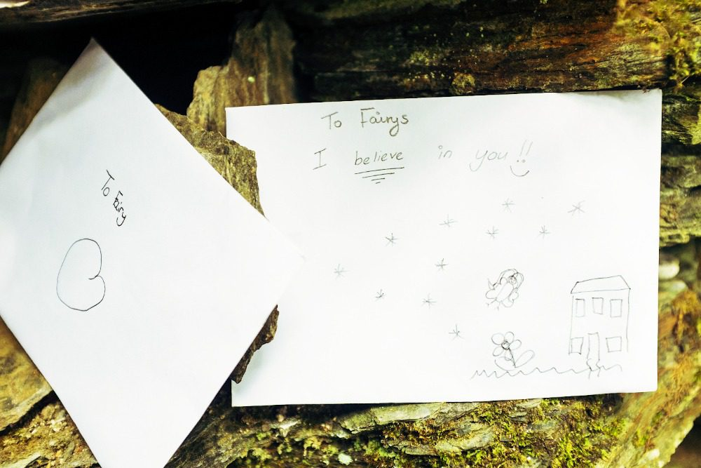 Letters to the lil' fellas left on the Old Fairy Bridge on the Isle of Man. The envelope reads 'to fairy' and the letter reads 'to fairys, I believe in you!!'.